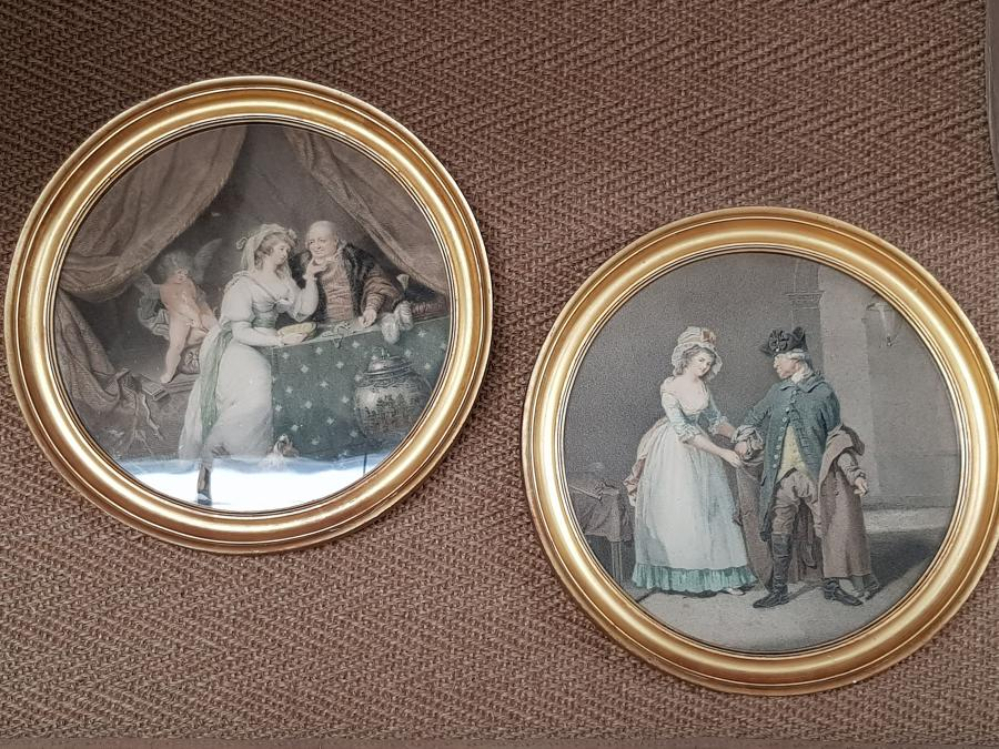 Pair of Georgian prints in round gilt frames