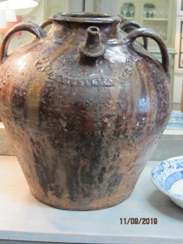 Antique French walnut oil jar