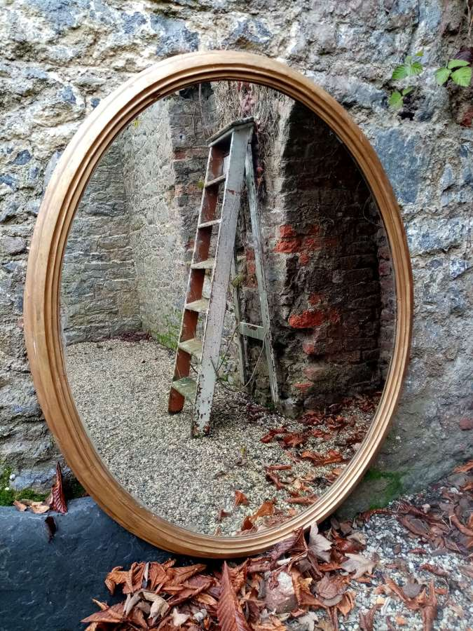 Large 19th c giltwood oval mirror